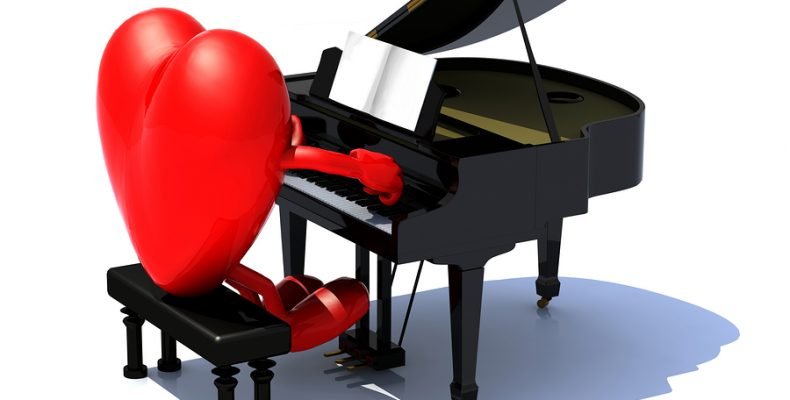 heart with arms and legs playing a piano love serenade concept.